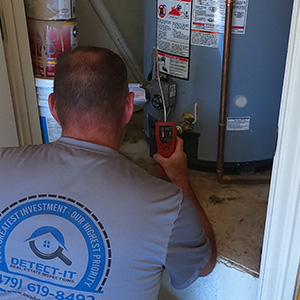 Checking for gas leaks at the water heater