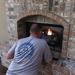 Inspecting gas fireplace operation