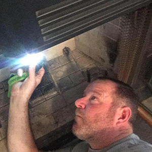 Inspecting a fireplace   Home Inspection Fayetteville AR